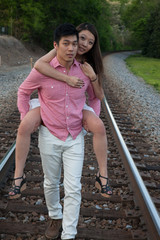 Romantic Asian couple playing outside