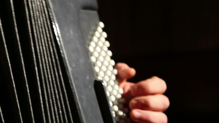 man plays the accordion