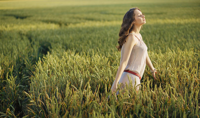 Relaxed woman on the corn field