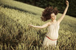 Portrait of the joyful pregnant woman among the cereal crop
