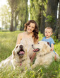Charming woman with son and two dogs