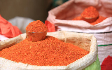 closeup of red spicy pepper powder selling at market