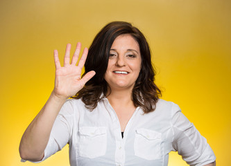 woman making five times sign hand gesture yellow background