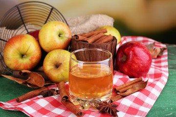 Composition of  apple cider in glass with cinnamon sticks,