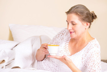 woman having breakfast, relaxing in hotel house home bed