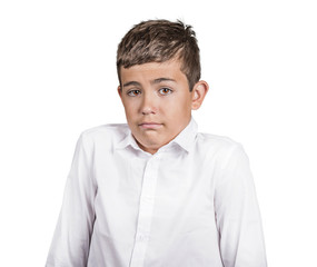 clueless young man shrugs shoulders on white background