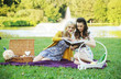 Two women reading book in the park