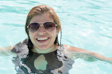 Middle age woman in a swimming pool