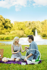 Couple having romantic date in the park
