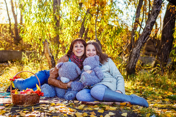 Family in the fall in park