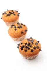 chocolate chips Muffins on a white background
