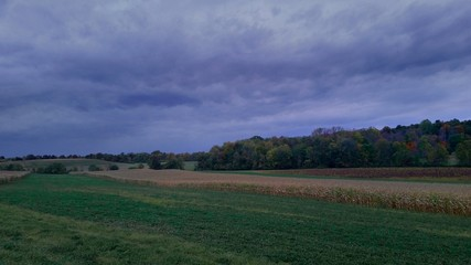 Fall landscape with storm clouds