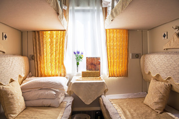 Сomfortable China train compartment (soft sleeper coupe).