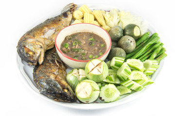 Shrimp paste with fried mackerel and vegetable isolate on white
