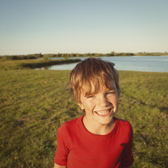 Portrait happy boy in red sweater,