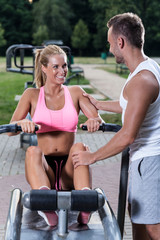 Young woman training on rowing machine