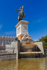 Statue of King in front of Royal Palace - Madrid Spain
