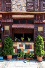 Turkey house front with colorful potted flowers