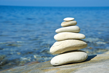 Pyramid of stones zen balance in sea shore