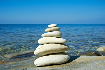 Pyramid of stones zen balance in sea shore