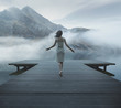Alluring woman walking on the wooden pier