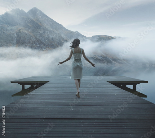 Alluring woman walking on the wooden pier - 71301823