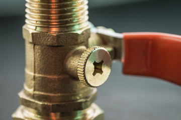 Close-up view of ball valve on dark background.
