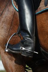 Close up of riding boot with metal spur