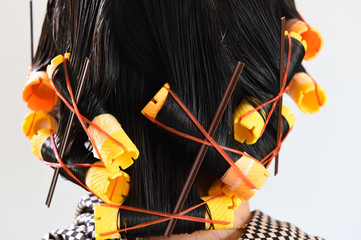 close-up of yellow curlers in hair