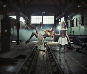 Two witches in the old and empty railway station