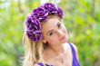 Beauty portrait of young pretty girl with flower wreath in her