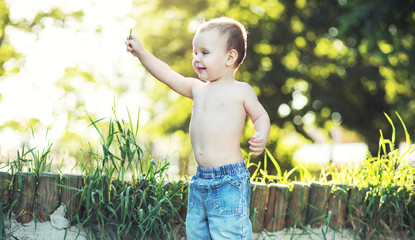 Small boy playing in the garden