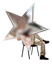 man sitting on a chair and holding a five-pointed star