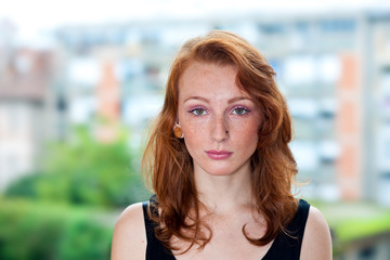 freckled girl with red hair portrait