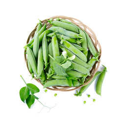fresh pea pods in a basket isolated on white