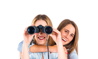 Friends with binoculars over isolated white background