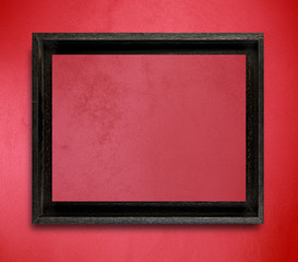 Black frame on red wall