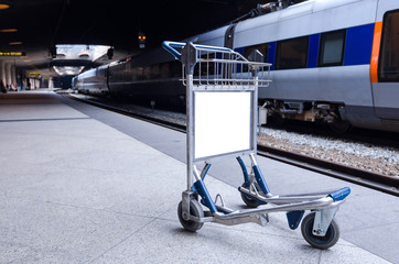 Empty luggage cart on the metro station