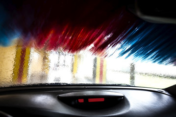 Motion blurred picture of car wash from inside a car during the