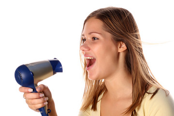 Girl singing to a hair drier