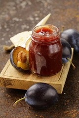 natural organic plum jam with fresh berries
