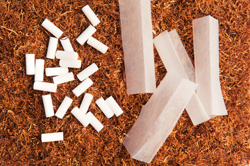 Tobacco, filters and smoking paper for rolling cigarettes.