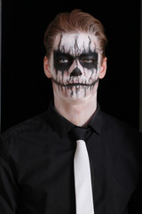 Portrait man with Halloween skull makeup. Halloween or horror th