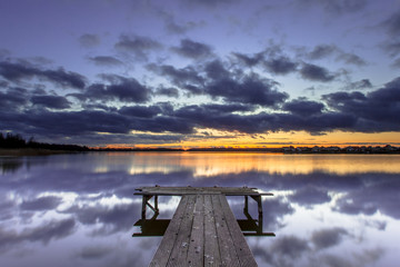 Purple Sunset over Wooden Jetty in Tranquil Lake
