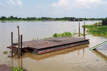 Floating pontoon on the river