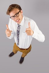 Young geeky businessman showing thumbs up