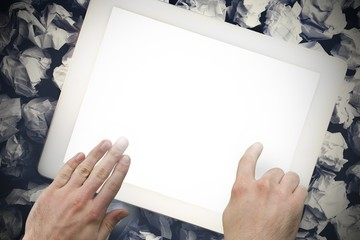 Hands touching tablet screen