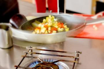 cooking sautè vegetables
