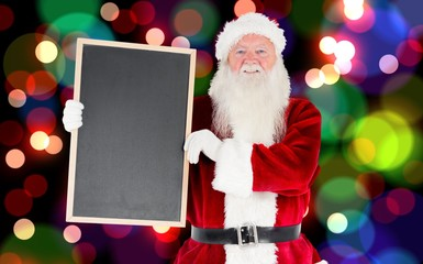 Composite image of santa claus showing blackboard