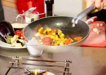sautè vegetables cooking inside pan